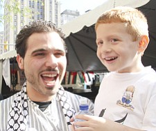 Mahammed Salman of Youngstown and his cousin Adam Omran of Canfield enjoy events at Arab American Festival of Youngstown Saturday in downtown Youngstown.