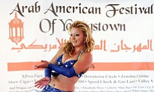 "Kelli Krzynowek, also known as ""Kelli Belly"" a member of Wind and Song Dance Troupe from Cleveland, performs during Arab  American Festival of Youngstown Saturday."