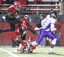 Willim D. Lewis the Vindicator   UNI's Terrell Sinkfield eludes YSU  defense to score during 1rst qtr.