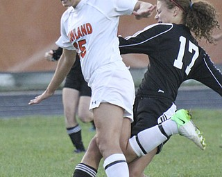 William D Lewis The Vindicator  Howland's Jenna Dorchock (25) and Canfield's Emma Seybert 17) go for the ball during Monday action at Howland.