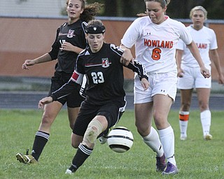 William D.Lewis The Vindicator  Canfield's Jen Morris (23) and Howland's Jenn Boyd (6)) go for the ball during Monday action at Howland. At left is Canfield's Emma Seybert(17).