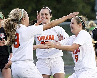 William D.Lewis The Vindicator Howland's Seyla Perez(9) gets congrats from Jenna Dorchock( 25) and Jenn Boyd(6) after scoring first goal during Monday action at Howland.