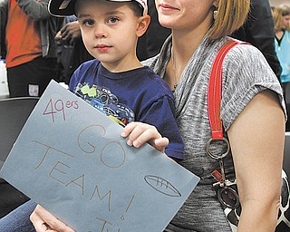 Tyler DeMoin, 4, and his mom, Marie, of Stuthers hold a sign welcoming the San Francisco 49ers to Akron Childrens Hospital of the Mahoning Valley on Monday. The team is spending the week in the valley before playing the Jets on Sunday.