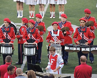 Drumline performs a percussion piece during pregame