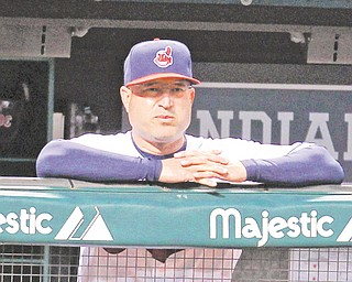 Cleveland Indians manager Manny Acta watches a game against the Detroit Tigers from the dugout at Progressive Field in Cleveland. The Indians announced Thursday — an off day before their final homestand — that Acta has been fired.