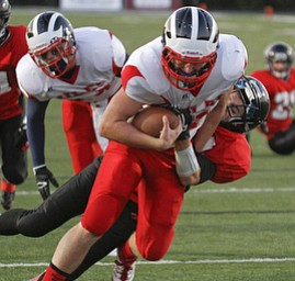 ROBERT  K.  YOSAY  | THE VINDICATOR --..#11 Niles John Cicero  goes into the Endzone draggin  Canfields #84 Kyle Nagy - as Niles scored in the first set of downs -.Niles at Canfield - Bob Dove Field ..(AP Photo/The Vindicator, Robert K. Yosay)