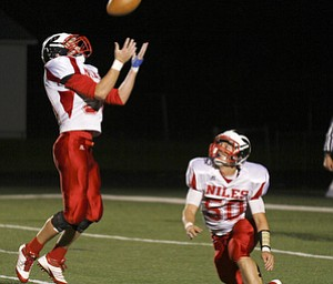 ROBERT  K.  YOSAY  | THE VINDICATOR --..After a tipped ball  Niles #0 Andres Sheets  hauls in the tip - as #50 Niles Jake Forward watches. the play was rulled dead - Niles at Canfield - Bob Dove Field ..(AP Photo/The Vindicator, Robert K. Yosay)