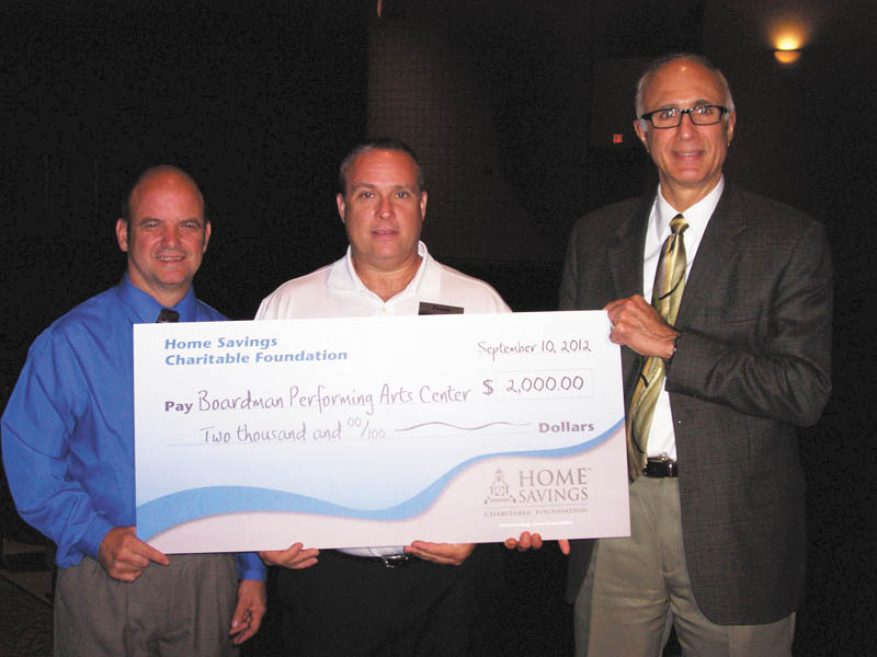 Boardman Performing Arts Center recently received a donation of $2,000 from Home Savings Charitable Foundation to help buy and install a new sound system that will improve the quality of its productions. From left are Nick Opritza, supervisor of the center; Frank Constantino, Home Savings Boardman office; and Frank Lazzeri, superintendent of Boardman School District. Darlene Pavlock is executive director of the foundation.