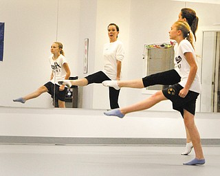 Holly Podbesek works with D'Ella Heschmeyer, 12, of Liberty on her Irish dance moves. Podbesek, who has been performing and teaching Irish dance for more than 30 years, recently purchased Northeast Martial Arts Dance and Fitness in Austintown and added the Sheridan Academy of Irish Dance to the schedule.