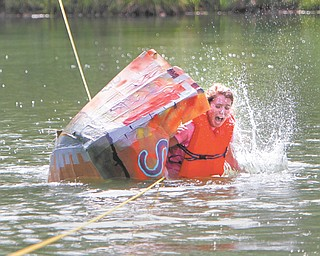South Range sophomore Mary Clare McCarthy and her safari-themed team are doing their best to capture the Titanic award for best unintentional sink at the 15th annual Raider Regatta on Monday. The boats were made using cardboard and duct tape.