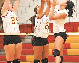 Howland's Megan Papalas tries to get a shot past Cardinal Mooney's Nichole Webber (25) and Lorena Cancel on Monday in the Cardinals' gym.