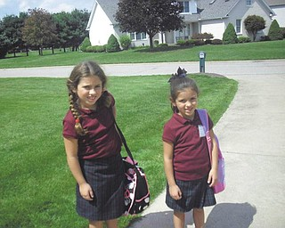 This is a picture of Breanna (3rd grade) and Alivia (kindergarden) Maderitz on their first day of school on Aug. 21. They both attend St. Charles in Boardman. Parents are Teresa and Joe Maderitz.