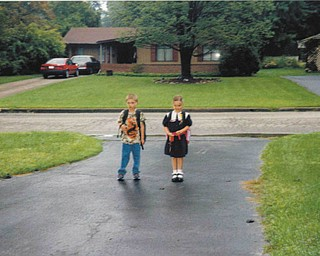 Melissa Pregi sent this picture of her son, Sean, on his first day of second grade and her daughter, Liana, on her first day in kindergarten. The photo was taken in September 2003, when the kids were heading off to West Boulevard in Boardman.