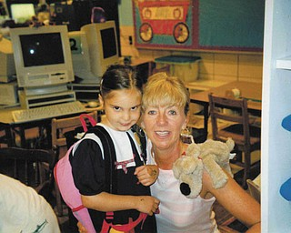 Melissa Pregi sent this picture of her, daughter, Liana, with her teacher, Mrs. Nadzam, on her first day in kindergarten at West Boulevard in Boardman in September 2003.