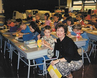 Melissa Pregi sent this picture of her, son, Sean, with his teacher, Mrs. Kinney, on his first day in second grade at West Boulevard in Boardman in September 2003.