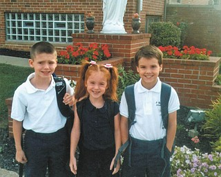 Theresa and Kevin Murphy of Bazetta sent this picture of the first day of school at St. Rose School in Girard for their children. Aidan is a fourth-grader, Alyse is a first-grader, and Liam is a second grader.