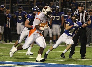 NICK MAYS l THE VINDICATOR  (4) De'Veon Smith tales off down field for a long gain past (4) Dave Morocco of Poland during thier game Friday night in Poland. howland vs poland 10052012 Poland, Ohio