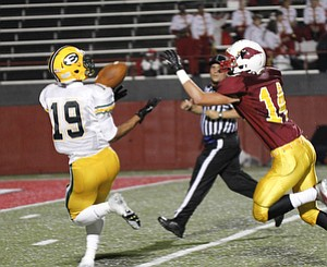 ROBERT K. YOSAY  | THE VINDICATOR..St Eds  #19....Anthony Young. pulls in a touchdown pass as Mooneys #14  Marcus Penza looks on - during first quarter action -..Lakewood St Edwards vs Cardinal Mooney at Stambaugh Stadium at YSU -... - -30-..