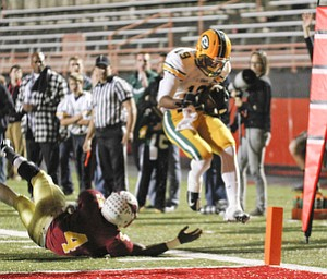 ROBERT K. YOSAY  | THE VINDICATOR...Jumping pass Mooneys #4 Marcus McWIlson  St Eds #19    Anthony Young-  gets the first TD for St Eds...Lakewood St Edwards vs Cardinal Mooney at Stambaugh Stadium at YSU -... - -30-..