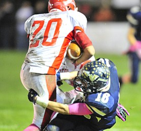 Brookfield's #16 RJ Leon holds on to Edgewood ball carrier #20 Dylan McCaleb to make the tackle.