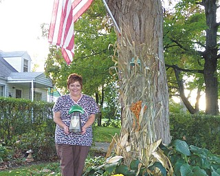 Kelly Ruble, of Scheetz Street, holds the Volney Rodgers Emerald Pierogi Trophy that she and her husband, Kent, won as the grand champions in the Rocky Ridge Neighborhood Association competition that recognizes efforts of home and lawn beautification. Other finalists were Milan and Donna Zordich of South Hazelwood Avenue, Sharon and Dave Jackson of Birch Hill, Chris and Jamie Romeo of Birch Hill and Pat Sedwick of Chaney Circle.