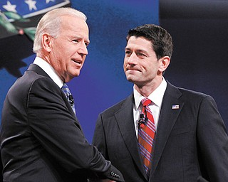 Vice President Joe Biden and Republican vice-presidential candidate Paul Ryan shake hands before the start of