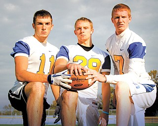 ) Jared Shilot, JJ Napierkowski, and Luke Griffith pose for a portrait on their field at Southern Local High School.