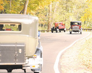 These Model A Fords wind their way through Mill Creek Park as part of the Penn-Ohio Model A Ford Club's fall foliage tour through the park.