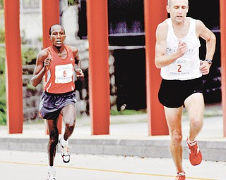 Matt Folk, front, a resident of Oregon, Ohio, collected $1,000 as the 10K winner of the 2009 Peace Race, while Elijah Nyabuti walked away from the awards table without a $500 check as runner-up because of a rule in which international runners must win in the open race or masters categories or go home empty. It's something race founder Jack Cessna wants addressed.