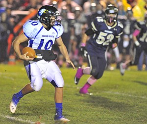 Youngtsown Christian quarterback #10 Emmett Underwood scrambles for a first down on a quarterback draw.