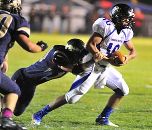 Youngtsown Christian quarterback #10 Emmett Underwood is sacked by Brookfield'd #10 Ron Kirilla.