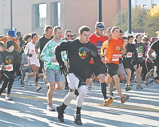 Runners in the 2-mile event of the Youngstown Peace Race dart through downtown Youngstown. The race Sunday attracted a record number of participants.