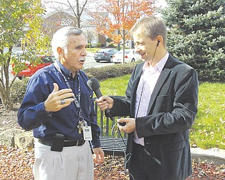 Marek Walkuski, right, of Polish Public Radio, interviews Poland Township Administrator Jim Scharville in Peterson Park, where a statue of Revolutionary War heroes Casimir Pulaski and Tadeusz Kosciuszko is displayed.