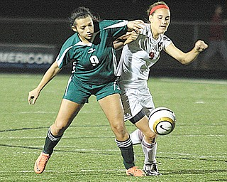 Canfield's Cheyenne Story, right, tries to keep West Branch's Braddin Williams from the ball during Monday's district semifinal girls soccer match.