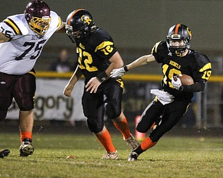 ROBERT  K.  YOSAY  | THE VINDICATOR --..Making a block of #22  (no name listed) blocks #75  Jake Ruiz - as Crestview #19  Nick Blower heads out of the back field and down the field for a TD( First Quarter).South Range at Crestview ..(AP Photo/The Vindicator, Robert K. Yosay)