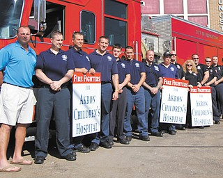 Members of the Youngstown Fire Department will be among nearly 10 fire companies that will be collecting donations at various locations Saturday to kick off Handel's Ice Cream's Koins for Kids campaign to raise money for Akron Children's Hospital Mahoning Valley. Their goal is to collect $100,000.
