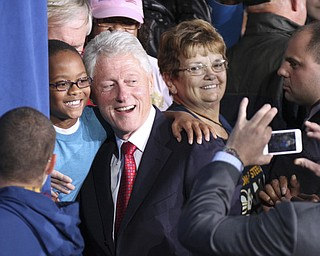 William d Lewis the vindicator   Bill Clinton poses for a photo during rally 102912 at Covelli.