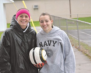Kaylee Buchenic, left, and Jen Morris are senior captains on the Canfield girls soccer team. Buchenic and Morris have been varsity players since they were freshman. They've been a part of three district championship teams. Now, the Cardinals gear up for the Division II regional tournament. They face Hathaway Brown tonight in Ravenna.