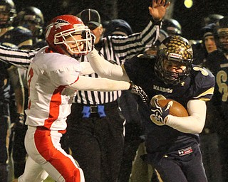 NICK MAYS l THE VINDICATOR (3) Ryan Mosora of Brookfield stiff arms (2) Jacob Cardona of Edgewood after a nice gain in the second quarter of thier game Friday night in Girard. ashtabula vs brookfield 11022012 Girard, Ohio