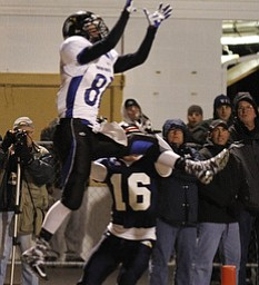 ROBERT K. YOSAY  | THE VINDICATOR..JFK #16 Robert Seger tries to stop YCS  #81  Nick Gonda as he leaps into the air to get the second touchdown for YCS of the night ..First round of playoffs as  Warren JFK matched up with Youngstown Christian at Mollenkopf in Warren... - -30-..