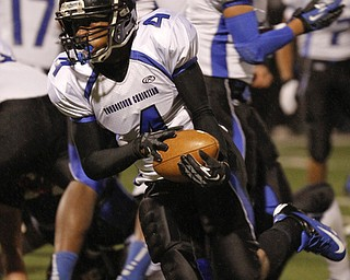 ROBERT K. YOSAY  | THE VINDICATOR..YCS #4   Paris Bennett  breaks thru the line and heads for  a short gain in first quarter action at Mollenkopf ..First round of playoffs as  Warren JFK matched up with Youngstown Christian at Mollenkopf in Warren... - -30-..