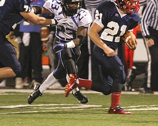 ROBERT K. YOSAY  | THE VINDICATOR..jfk# 21  as YCS #23  Ryan Grier gives chase   gets blocked by  number 72 for JFK = First round of playoffs as  Warren JFK matched up with Youngstown Christian at Mollenkopf in Warren... - -30-..