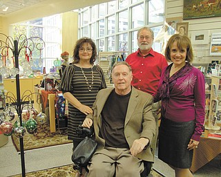 """Among the committee members for the 42nd Annual American Fine Arts and Crafts Show, """"An American Holiday,"""" at the Butler Institute of American Art are, from left, Audrey Korenic, John MacIntosh, Rick Shale and Cynthia Perantoni Anderson, chairwoman."""