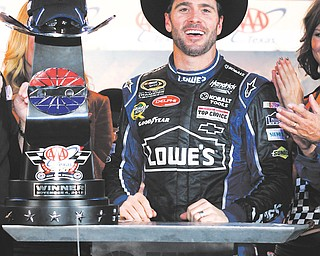 Jimmie Johnson is all smiles in Victory Row following Sunday's win at Texas Motor Speedway. It was the second victory in a row for Johnson, who is the Sprint Cup points leader with two races to go.