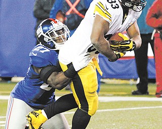 Steelers running back Isaac Redman (33) is tackled by Giants strong safety Stevie Brown (27) during Sunday's NFL game in East Rutherford, N.J. Redman rushed for 147 yards and scored the touchdown that gave Pittsburgh the 24-20 win over New York.