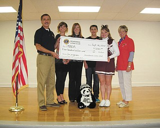 Boardman Lions Club recently made a $500 donation to the Boardman Center Middle School PANDA organization. From left to right are Terry Shears, Boardman Lions president; Mindy DePietro, Boardman Center Middle School counselor; Beth Bonish, PANDA coordinator; Bobby Morren and Madeline Kvasnasky, eighth-grade PANDA leaders; and Kris Dailey, Boardman Lions board member. PANDA, which stands for Prevent and Neutralize Drug and Alcohol Abuse, is no longer funded through the state. It is a program of Meridian Community Care that encourages responsible decisions about bullying, depression, violence, self-esteem and other issues and it meets every other Wednesday at the school.