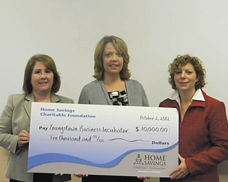 Youngstown Business Incubator, a charitable, nonprofit organization, recently was presented with a check for $10,000 from the Home Savings Charitable Foundations in support of its entrepreneurial support and development services. Holding the oversized check are. from left, Betty Jo Licata, Dean of Williamson College of Business at Youngstown State University; Trish Mohan, branch manager of Home Savings main office; and Barbara L. Ewing, chief operating officer of Youngstown Business Incubator. Located in downtown Youngstown, the incubator facilitates the creation of high-value businesses through collaborative partnerships that promote innovative technologies.