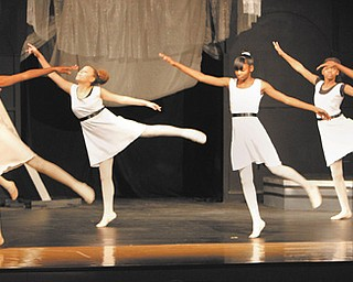 """Intermediate ballet students in the Visual and Performing Arts program at Chaney perform to music from """"Star Wars"""" on Wednesday afternoon during Dance by Design."""