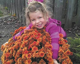 Three-year-old Harlow looks like she's giving a great big hug to these mums. She's the daughter of Jerret and Erin Kolesar of Boardman.