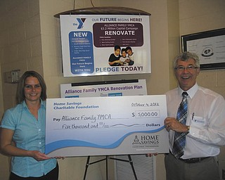Alliance Family YMCA, a local, nonprofit organization, recently received a check for $5,000 from the Home Savings Charitable Foundation. Holly Gaston, left, from Home Savings Salem office, is shown presenting the check to Dale Nissley, executive director of the YMCA. Nissley said funds will go toward the renovation of space for an adult cycling center that will accommodate up to 30 participants. For information on the Alliance Family YMCA call 330-823-1930 or visit www.ymcastark.org.